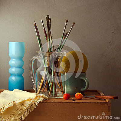 Still life with brushes, melon and blue vase