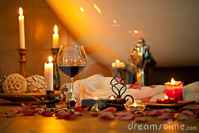 Still life with candles and red wine