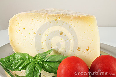 Still life with cheese and basil
