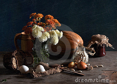 Still life with chrysanthemums and pumpkin