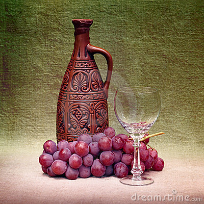 Still-life with clay bottle, glass and grapes