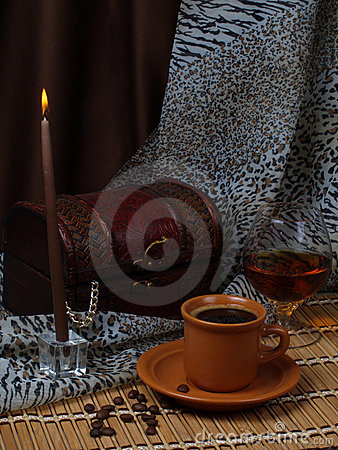 Still life. Coffee, candle, alcohol.