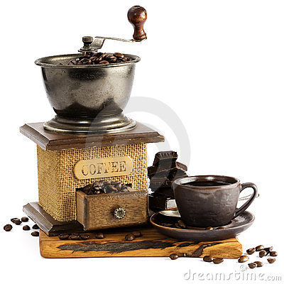 Still life with cup of coffee and coffee-mill