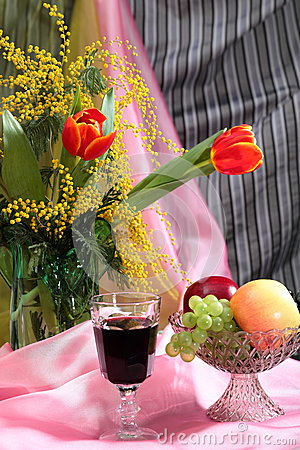 Still life with flowers, red wine and fruits