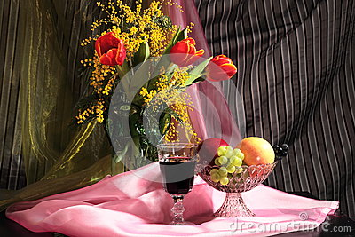 Still life with flowers, wine and fruits