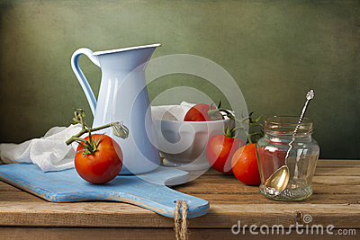 Still life with fresh tomatoes and tableware