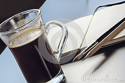 Still life with a glass of coffee, artist´s notebook