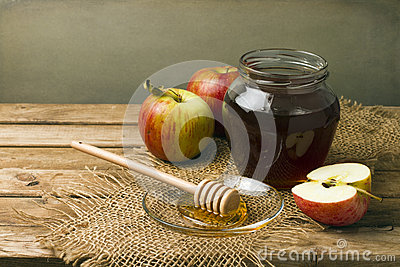 Still life with honey and apples