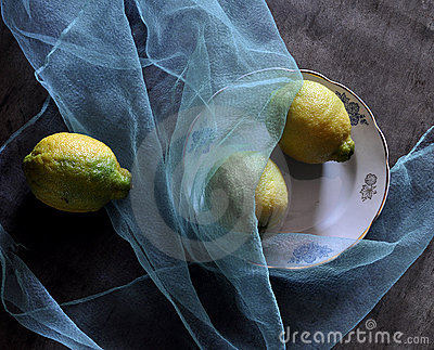 Still life with lemons and blue fabric
