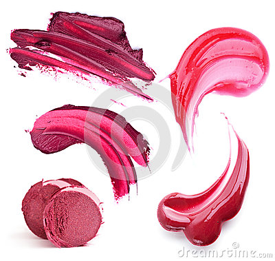 Still life of a lipstick and lip gloss rich wine and berry shades
