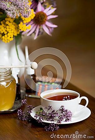 Still life from medicinal herbs, honey, herbal tea and medicines