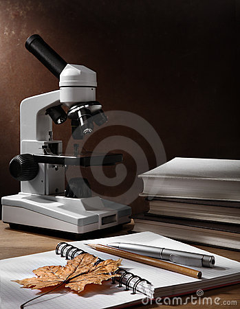 Still-life with microscope and books