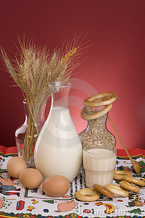 Still life with milk, cereals, grains and eggs.