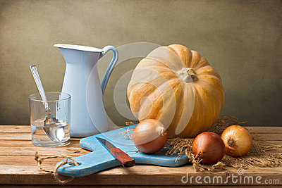 Still life with pumpkin and blue jug