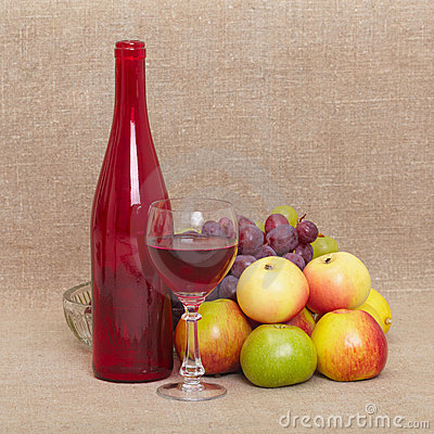 Still-life - red bottle of wine and fruit