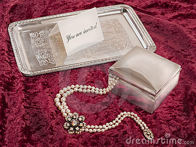 Still life with silver box and tray with invitation