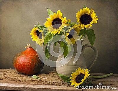 Still life with sunflower bouquet and pumpkin