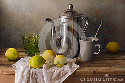 Still life with teapot and lemons