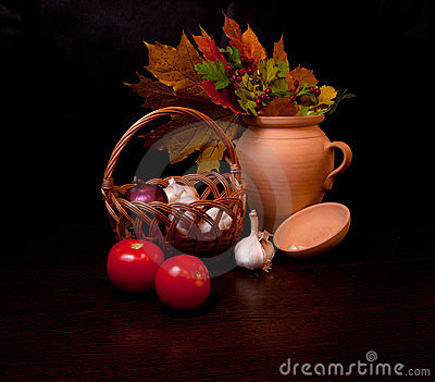 Still life with vegetables and autumn leaves