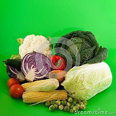 Still life vegetables on green background