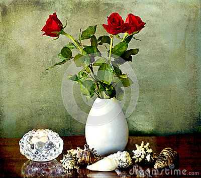 Still llife with red roses candle and shells