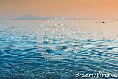 Still sea and distant island