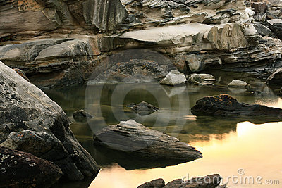 Still water in rock pool