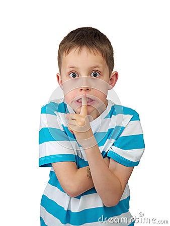 Stilte! - Gespannen jongen met grote ogen, vinger door lippen