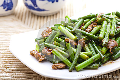 Stir fried garlic scape and shredded pork