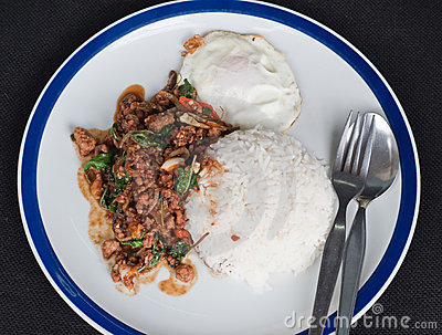 Stir fried pork with holy basil and fried egg