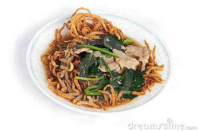 Stir-fried rice noodle with gravy on dish