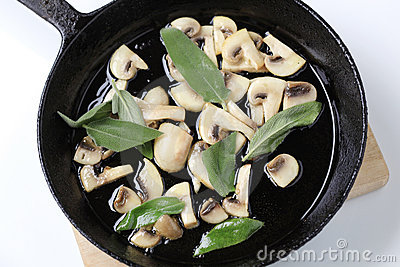 Stir frying mushrooms