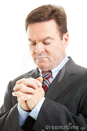 Stock Photo of Businessman Praying
