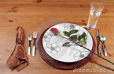 Stock Photo of a red rose on a plate