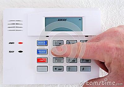 Stock Photo: Setting the Alarm System