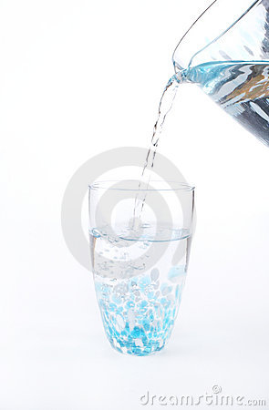 Stock photo of water being poured into a glass