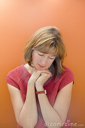 Stock Photo of a Woman on Orange Background