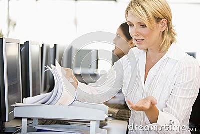 Stock Trader Going Through Paperwork
