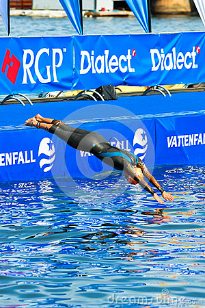 Free STOCKHOLM - AUG, 24: Natalie Milne Diving Into The Water Before Stock Photo - 33176960