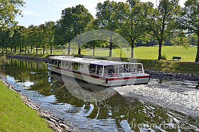 Stockholm sightseeing boat in canal Editorial Stock Image