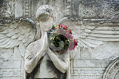 Stone angel with flowers