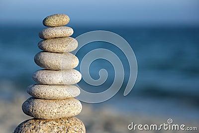 Stone balance pebble stones on beach