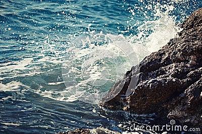 Stone breakwater with breaking waves.