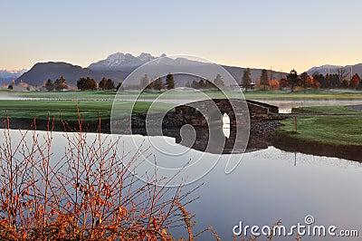 Stone bridge over creek on golf course