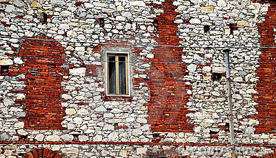 Stone building with brick repairs
