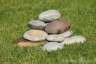 a stone cairn in the grass