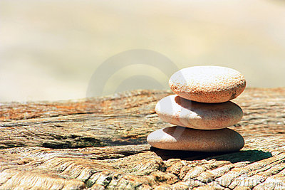 Stone cairn on a wood