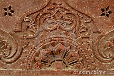 Stone carvings on the temple wall, India