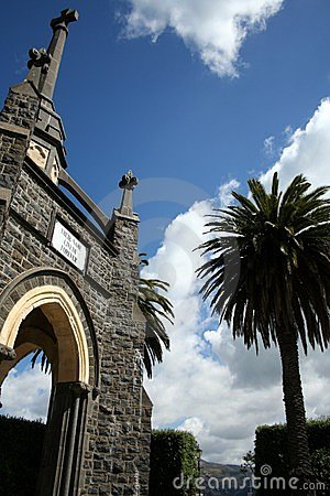 Stone church and palm tree