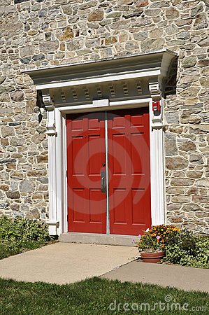 Stone church and red doors